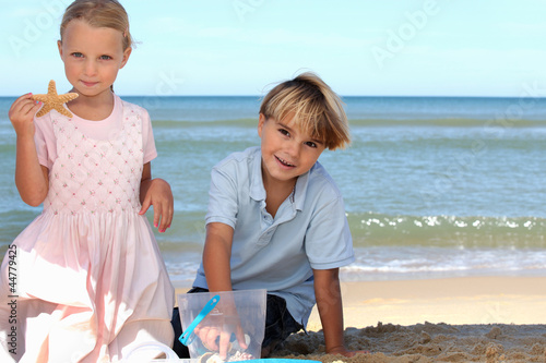 Brother and sister playing on the beach