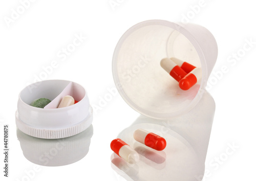 Dispensers for tablets with pills isolated on white
