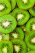 Obrazy drukowane na płótnie, fototapety, zdjęcia, fotoobrazy cyfrowe : Kiwi fruit slices background