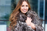 beautiful girl in fur coat in winter