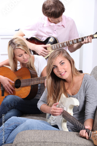 Young people playing guitars