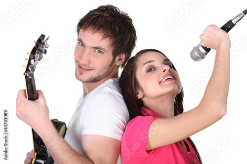 Cleancut young people in a rock band