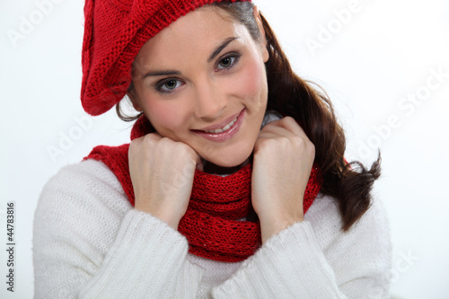 young woman wearing scarf and bonnet