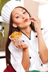 Female chef holding  food.