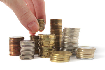stacks of coins and hand isolated on white.stacks of coins and h