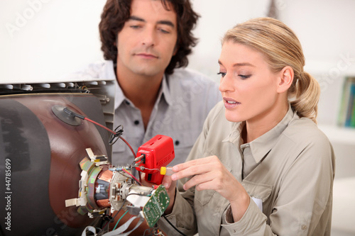 Couple fixing television