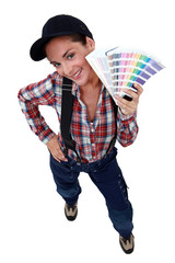 Woman displaying paint colour samples