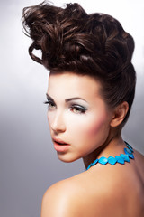 Glamour beautiful woman model with amazing makeup and hairstyle
