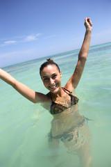 Happy woman bathing in the sea