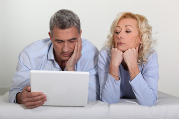 Older couple with a laptop