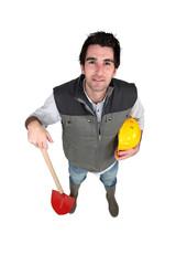 Handyman holding a shovel.