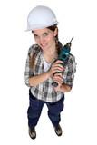 Tradeswoman holding an electric screwdriver