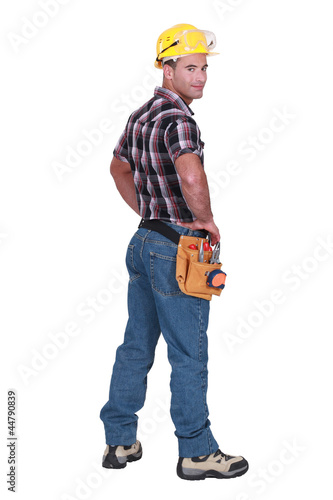 Portrait of a tradesman looking over his shoulder
