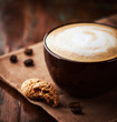 Cup of latte coffee with biscotti