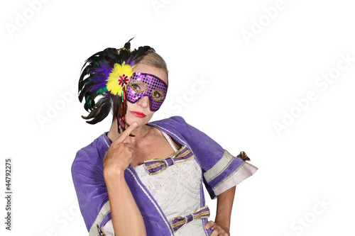 Woman in masquerade outfit