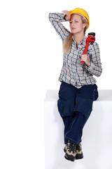 Tired female plumber