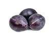 Three fresh blue plums on the white background