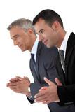 Two businessmen applauding