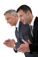 Two businessmen applauding