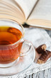 Cup of tea, candy and book