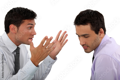 Two young businessmen having an argument