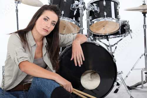 Woman posing with her drum set