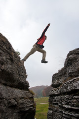 Man jump between rock