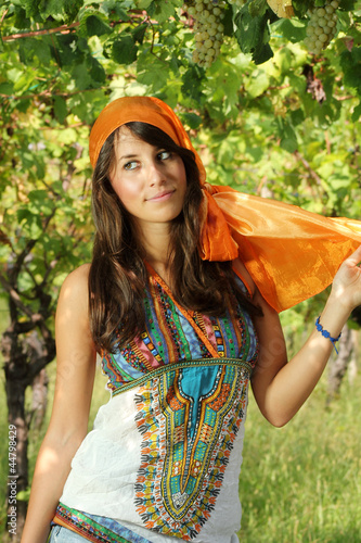 Beautiful girl dressed gypsy style in a vineyard