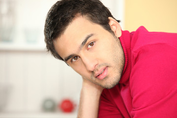 Man wearing red polo in kitchen
