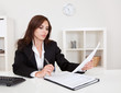 Businesswoman With Paperwork