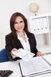 Businesswoman Offering Secret Envelop