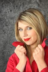 Seductive blond wearing red lip-stick