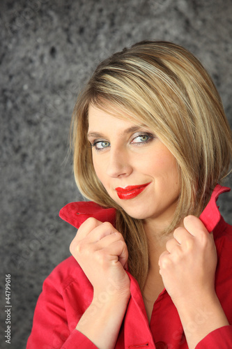Seductive blond wearing red lip-stick