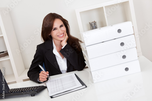 Businesswoman With Lots of Paperwork