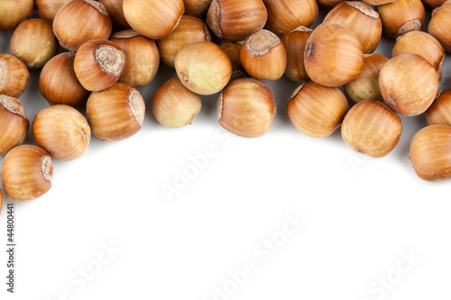 Hazelnuts pile isolated on white background