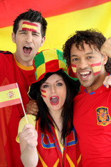Three Spanish football fans