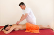 Physical therapist giving a back massage