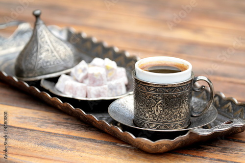 Turkish coffee and turkish delight with traditional cup and tray