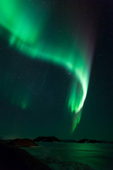 Northern lights over frozen lake Myvatn in Iceland