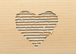 Ripped heart shaped corrugated cardboard, brown background
