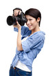 Woman takes images holding photographic camera