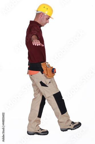 Builder walking tight rope