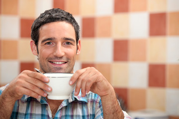 Man enjoying cup of coffee