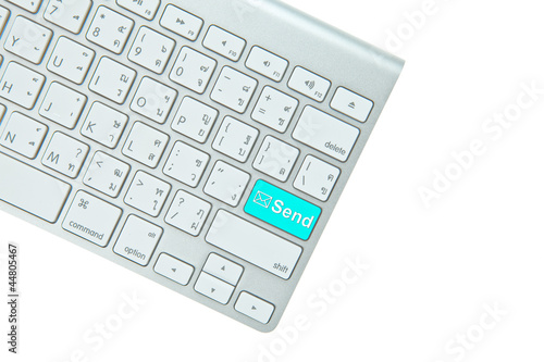 Blue send button on computer keyboard isolated on white backgrou