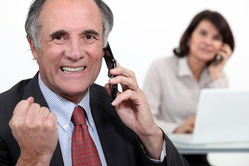 Successful businessman on phone