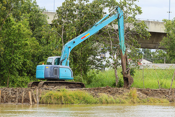 excavator loader machine during earthmoving works outdoors at co