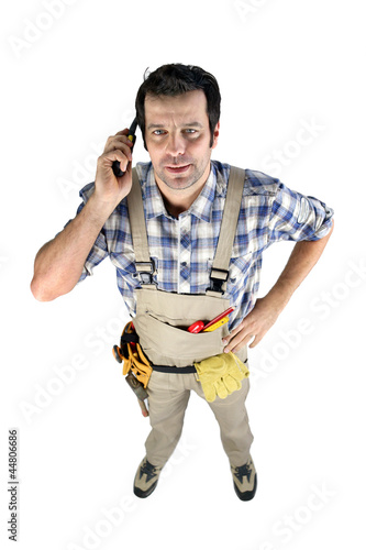 Workman on phone isolated on white background