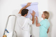 Man and woman choosing wallpaper