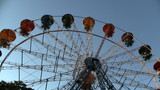 Ferris wheel rotates on blue sky background HD 1080p