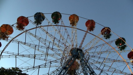 Ferris wheel rotates on blue sky background HD 1080p